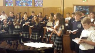 Kids singing in group