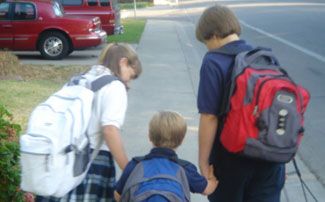 siblings walking to school together