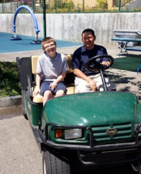 boys in golf cart, image