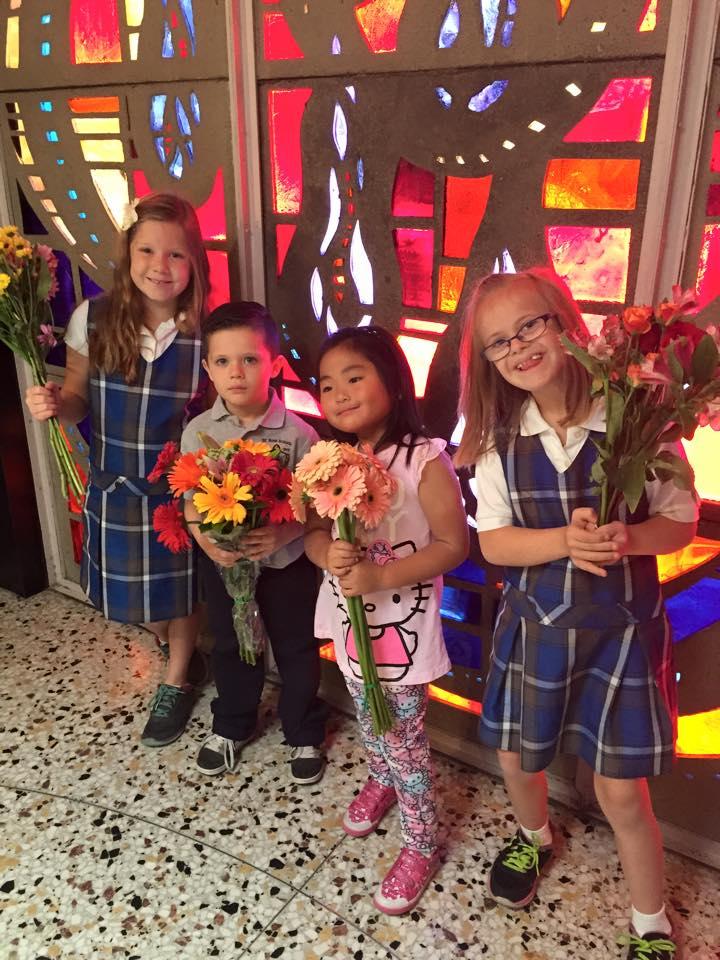 Mia bringing flowers up to altar at May Crowning Mass