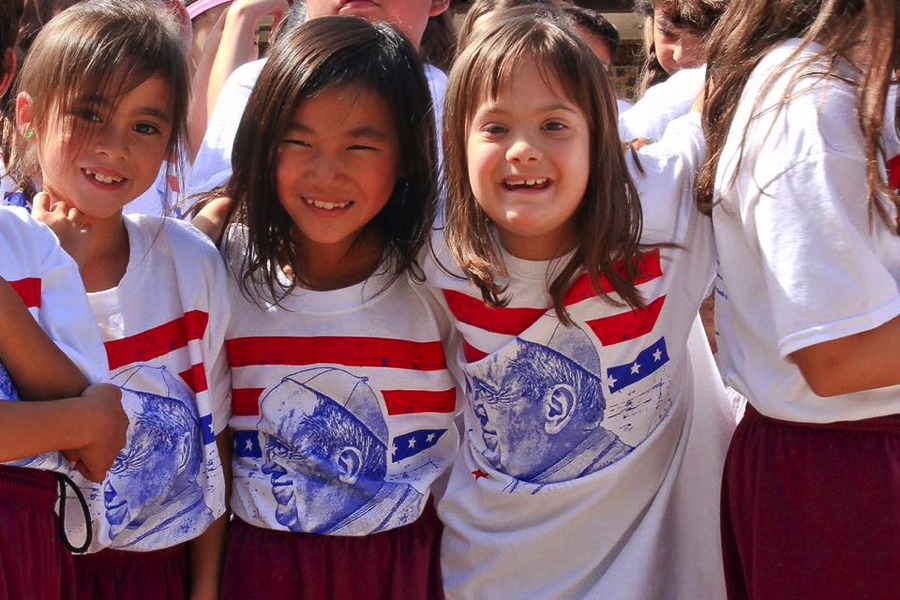 Bella and classmates celebrating the Pope's historic visit to Washington, DC in September 2015. Bella attends Nativity Catholic School in Burke, VA – fully included in 2nd grade.