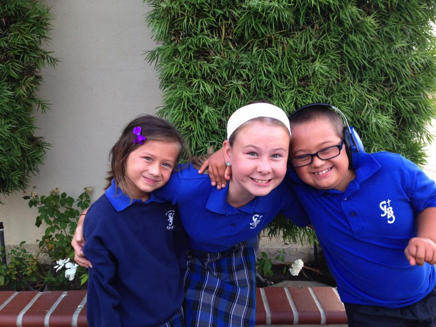 Natalie (6th grade) and Jonathan (3rd grade) can't wait to show their sister, Allison, in Kindergarten all the secrets of St. John the Baptist School in Costa Mesa, California.