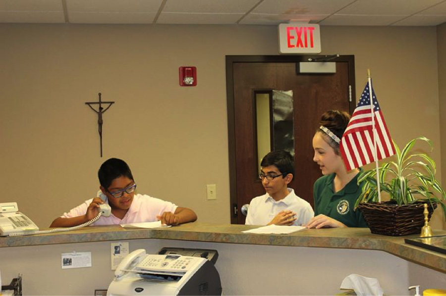 Raymond at Our Lady of Perpetual Help in Scottsdale, AZ, saying the Pledge of Allegiance during morning announcements for the entire school