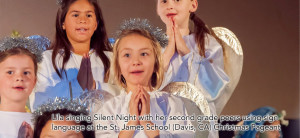 Lila singing Silent Night with her second grade peers using sign language at the St. James Christmas Pageant.