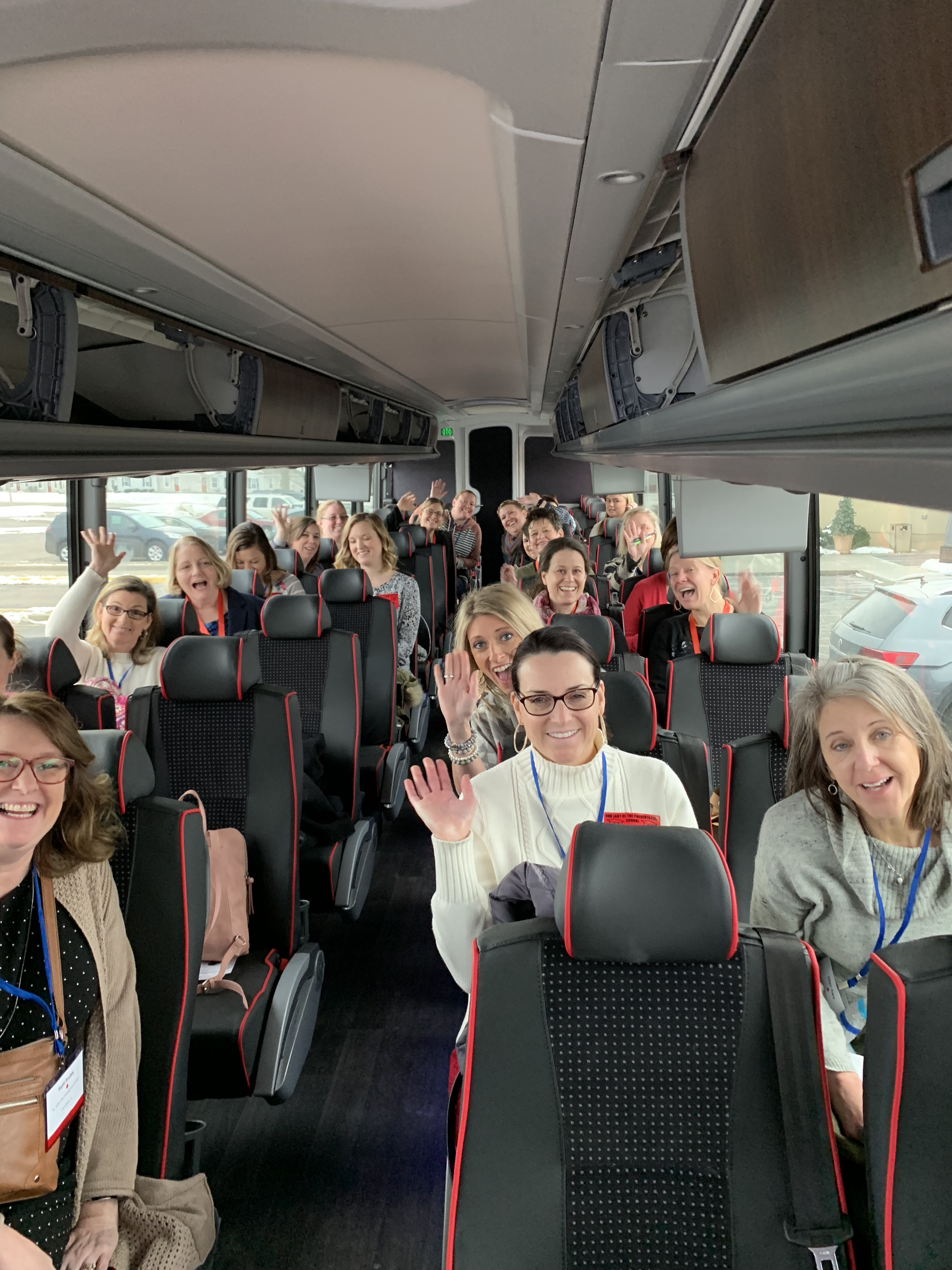 An inside picture of a full bus of educators.